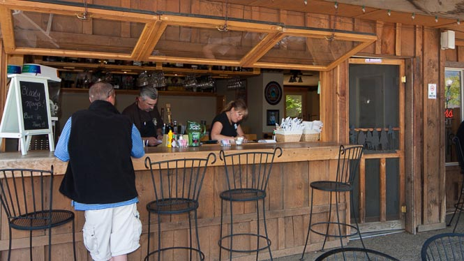 From the dining patio you can belly-up to the bar.